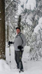 Male hiker in snow